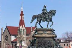 Bronze rider's monument and St. Franics Xavier Church Royalty Free Stock Photo