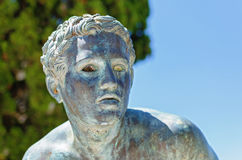 Bronze runner on achillion terrace. In achilleion corfu Royalty Free Stock Photography