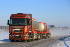 Bronze Scania R560 V8 Tank Truck on Winter Road Stock Photo