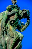 Bronze sculpture with blue sky. Close-up of bronze sculpture with blue and sunny sky. In a square at the Orvieto city center, an ancient, pleasant and well royalty free stock photography