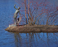 The bronze sculpture `The Boy with the Fish` Royalty Free Stock Images