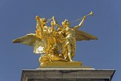 Bronze Sculpture. A bronze sculpture on one of the columns of the Alexander Bridge in Paris Stock Photo