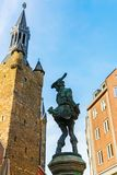 Bronze sculpture called The Hen Thief in the old town of Aachen, Germany royalty free stock image