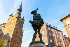 Bronze sculpture called The Hen Thief in the old town of Aachen, Germany stock photography