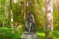 Bronze sculpture of Calliope - the muse of epic poetry and knowledge. Old Silvia park in Pavlovsk, St Petersburg, Russia. PAVLOVSK, ST PETERSBURG, RUSSIA stock photos