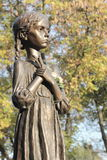 A bronze sculpture of a child Stock Photography