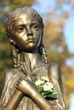 A bronze sculpture of a child Royalty Free Stock Image