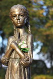A bronze sculpture of a child Stock Images
