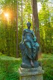 Bronze sculpture of Euterpe - the muse of music and eloquence. Old Silvia park in Pavlovsk, St Petersburg, Russia Stock Photos