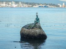 Bronze sculpture, girl in a Wetsuit at Stanley Park in Vancouver stock photography