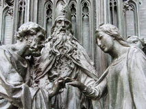Bronze sculpture of the holy family wedding. A close-up of the main gate of the Milan's cathedral representing the wedding between St. Joseph and the Virgin Mary Stock Image