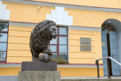Bronze sculpture of lion with ball Royalty Free Stock Photos