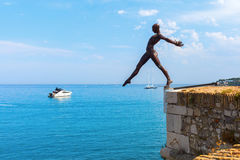 Bronze sculpture of Nicolas Lavarenne in Antibes, France. Antibes, France - July 24, 2016: bronze sculpture in Antibes. It is an outdoor exhibition in the city stock image