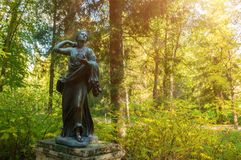 Bronze sculpture of Niobida dying of an arrow of Artemida. Old Silvia park in Pavlovsk, Saint Petersburg, Russia. Pavlovsk, St Petersburg, Russia - September 21 Stock Photography