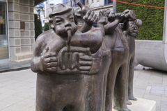 Bronze sculpture of stylized musicians in downtown Skopje, Maced royalty free stock photo
