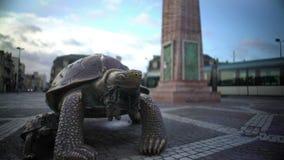 Bronze sculpture of turtle standing on Place de la Victorie in Bordeaux, France. Stock footage stock video footage