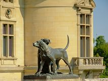 Hunting dogs, bronze statue , detail of the Castle of chantilly, france. Bronze sculpture of two hunting dogs, detail of castle of chantilly, france, no royalty free stock photos