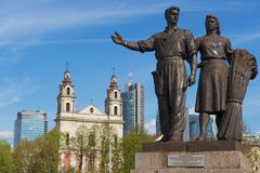 Bronze sculpture of worker and farm woman in Soviet Realism style at the Green Bridge in Vilnius, Lithuania. Stock Image