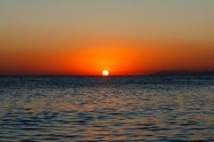 Bronze sea sunset with bluntly and blue sea. Bronze sea sunset and blue deep sea royalty free stock photos
