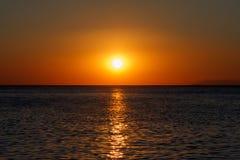 Bronze sea sunset whit gold sunny road. Bronze sea sunset whit sunny road stock image