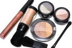 Bronze set for make-up. Eyeshadows, rouge, blusher and gloss Royalty Free Stock Images