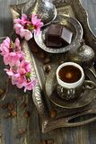 Bronze set for Turkish coffee and blossoming branc Stock Photos