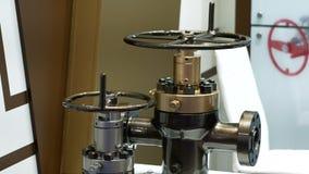 Shiny valves at Expo. Bronze shiny valves at the exhibition. Close up stock footage