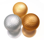 Bronze, silver, gold golf balls. On white Royalty Free Stock Image