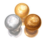 Bronze, silver, gold soccer balls. On white separated Royalty Free Stock Photography
