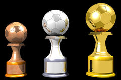 Bronze, silver and gold soccer trophies (3D). Photo of Bronze, silver and gold soccer trophies (3D Royalty Free Stock Photos