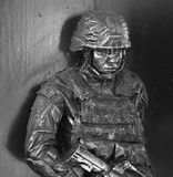 Bronze of soldier with machine gun and armor Royalty Free Stock Photo