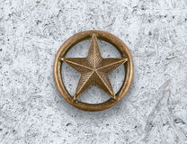 Bronze star on cement background Royalty Free Stock Image