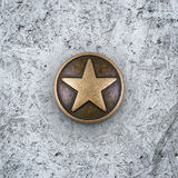 Bronze star on cement background Royalty Free Stock Images