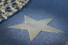 Bronze star in pavement. Bronze star in marble pavement Stock Image