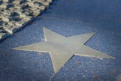 Bronze star in pavement Stock Image