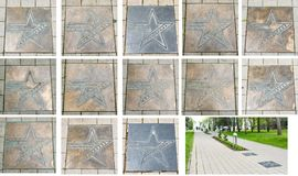Bronze star plates with the names of Russian movie stars and Star Avenue of movie actors near the central square near the. Administration of  Anapa stock photos