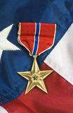 Bronze star on USA flag Royalty Free Stock Photography