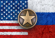 Bronze star on USA and Russian flags in background Stock Images