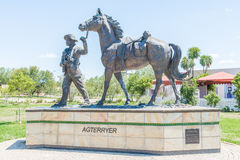 Bronze statue of an agterryer Stock Photos