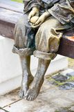 Bronze statue of  barefoot   child holding egg Royalty Free Stock Photography