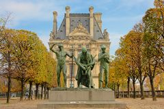 Statue of Cain and his sons in Tuileries park, Paris, France. Bronze statue of the biblical figure Cain and his sons by Paul Landowski in Tuileries park, Paris stock image