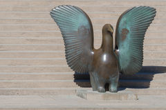 Bronze statue of bird by Nunavut native artist. Royalty Free Stock Photo