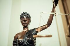 Lady justice. Bronze statue of the blind and impartial Lady Justice holding scales Royalty Free Stock Image