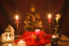 Bronze statue and candles Royalty Free Stock Image