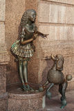 Bronze statue of characters from fairy tale Malvina and Artemon. Kiev. Ukraine. Bronze statue of characters from fairy tale Malvina and Artemon near the Academic Royalty Free Stock Photo