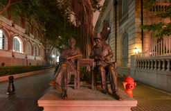 Bronze Statue of Chinese and Europeans traders at the evening, winter, Shamian Island Royalty Free Stock Photos