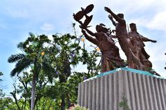 Bronze Statue of Christianity. In the front of San Pedro Cathedral in Davao, Philippines Stock Images