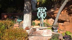 Bronze statue with cross. At Sedona, United States stock footage