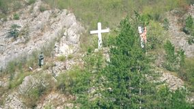 Bronze statue and cross on the hill. This is footage of bronze statue and cross on the hill stock footage