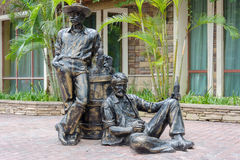 Bronze statue of drinking men and barrel stock photography